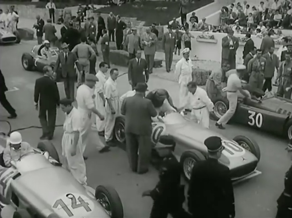 Castelotti getting into his Lancia at the start of the race, lancia on the pole